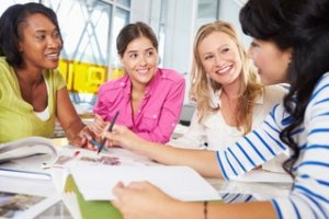 Group Of Women Meeting In Creative Office